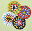 Rosettes, beaded 2 inch red,yellow,white,black,turquoise