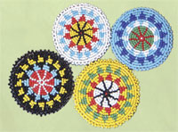 Rosettes, beaded 2.5 inch red,yellow,white,black,turquoise